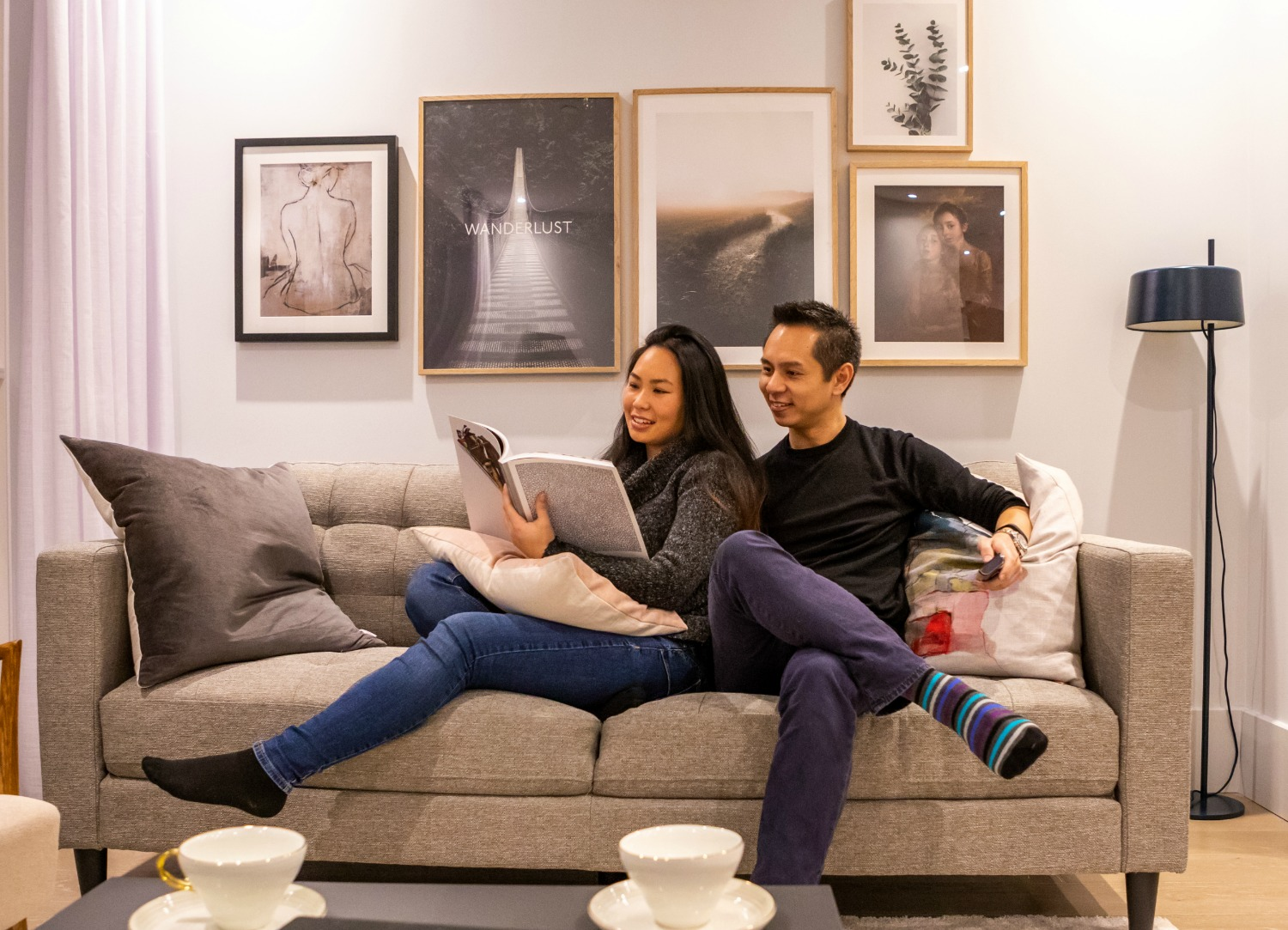 A couple relaxing on the couch in a Leon House flat