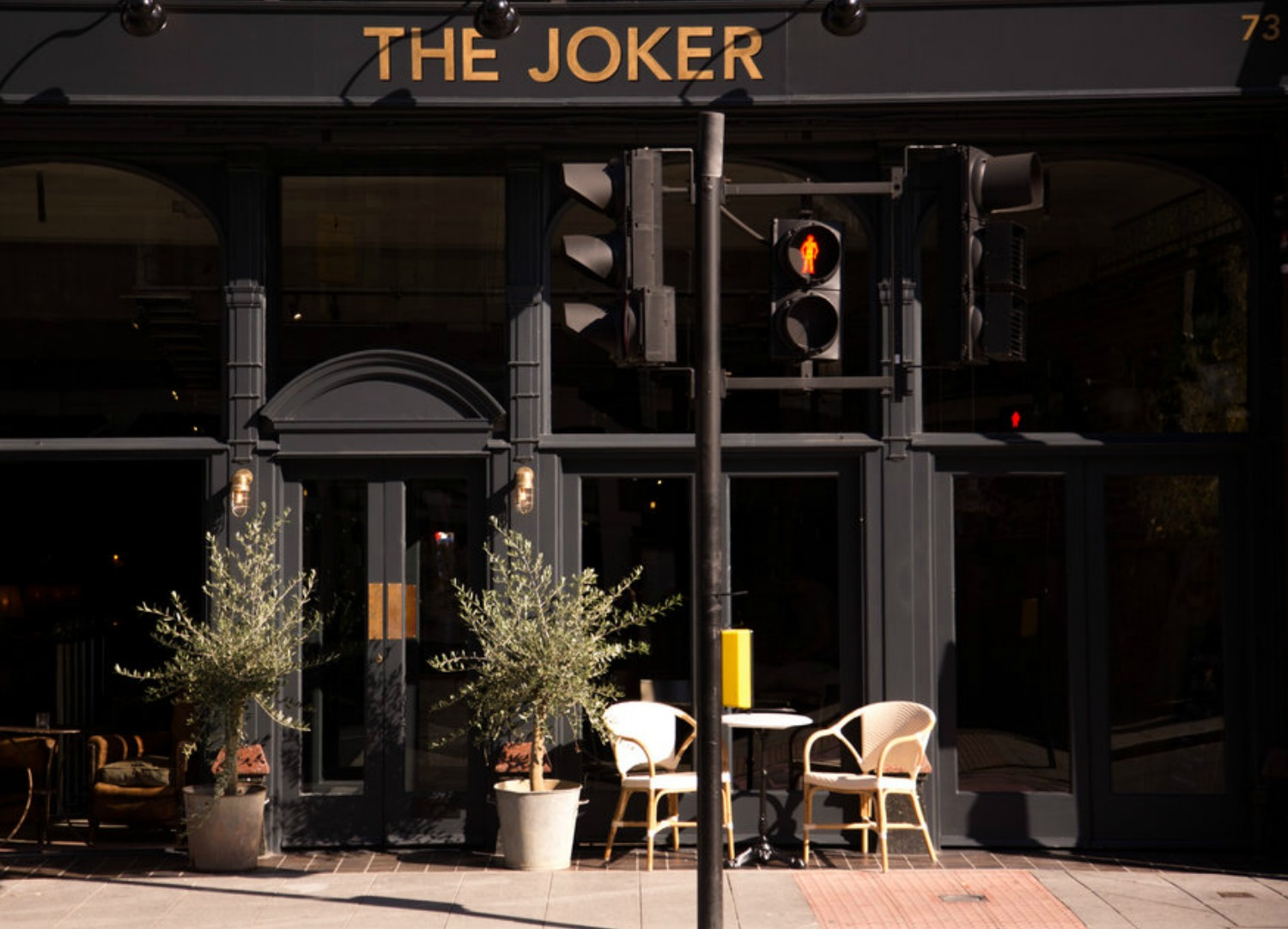 The outside of a neighbourhood bar called The Joker in Croydon